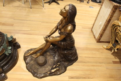 "Lady on Stone Bronze Statue -  Size: 33""L x 23""W x 34""H."