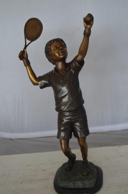"""Boy Playing Tennis Bronze Statue -  Size: 12""""L x 8""""W x 25""""H."""