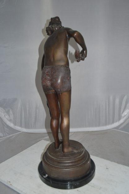 "Boy holding a Dog and a Bird Bronze Statue -  Size: 15""L x 15""W x 36""H."