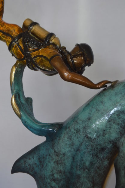 """Diver With Dolphin Bronze Statue -  Size: 10""""L x 30""""W x 49""""H."""