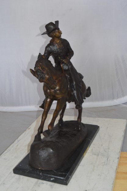 "Remington Cowboy on marble Bronze Statue -  Size: 24""L x 9""W x 23""H."