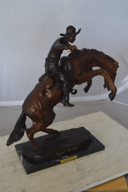"Bronco Buster Bronze Statue by Remington -  Size: 9""L x 24""W x 21""H."