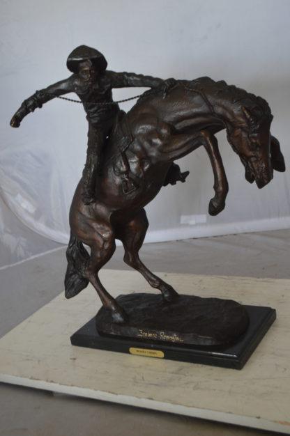 "Wooly Chaps Bronze Statue by Remington -  Size: 19""L x 11""W x 23""H."