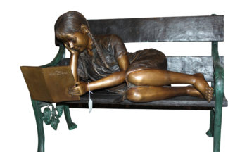"""Girl laying on a bench reading a book Bronze Statue -  Size: 27""""L x 39""""W x 32""""H"""