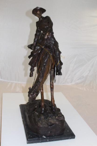 """Outlaw Remington Bronze Statue -  Size: 19""""L x 10""""W x 26""""H."""