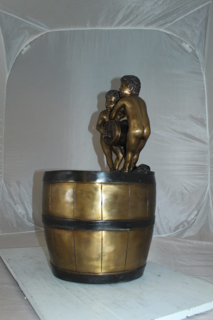"""Two boys on a bucket self-contained fountain bronze statue -  16"""" x 16"""" x 29""""H."""