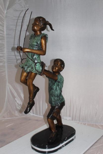 "Children-on-swing-Bronze-Statue -  Size: 20""L x 9""W x 39""H."