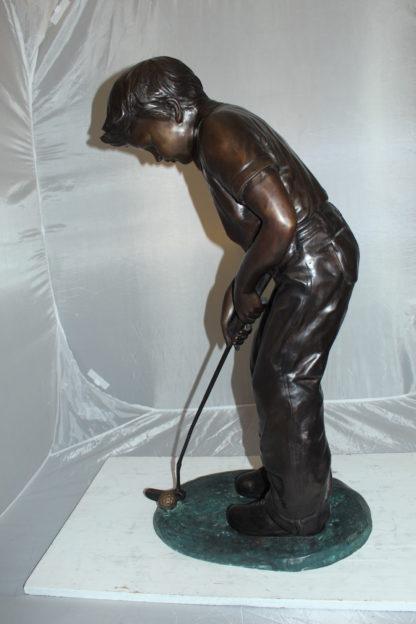 "Boy plays golf Bronze Statue -  Size: 14""L x 18""W x 37""H."