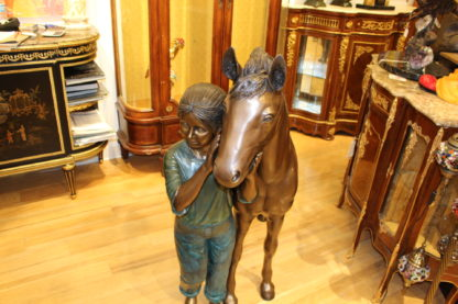 "Young Girl and her pony Bronze Statue -  Size: 48""L x 20""W x 48""H."