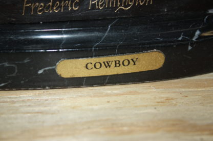 "Remington Cowboy on marble Bronze Statue -  Size: 10""L x 3.5""W x 10""H."