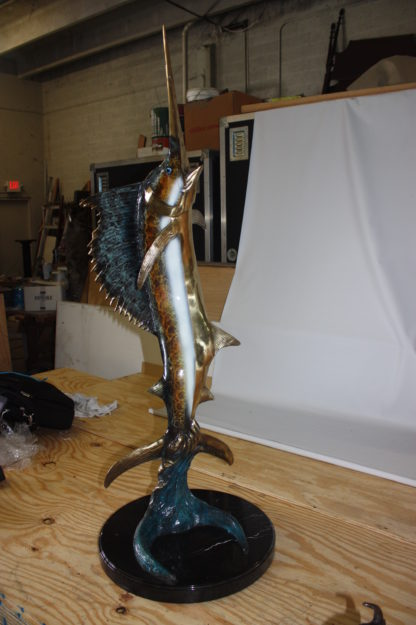 """One sailfish on a marble - Bronze Statue -  Size: 17""""L x 17""""W x 46""""H."""
