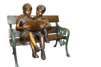 """Kids Reading a Book on a Bench Bronze Statue -  Size: 23""""L x 38""""W x 37""""H."""