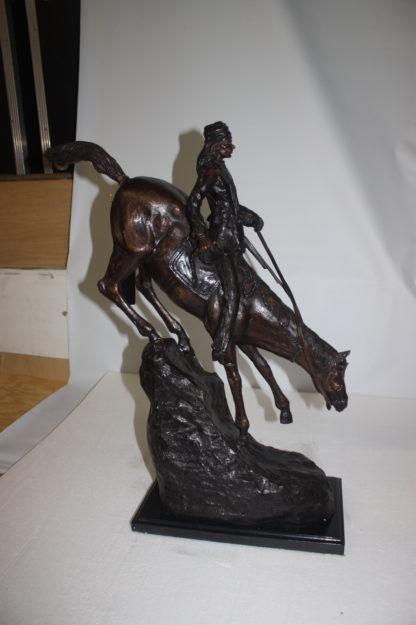 """Mountain man Bronze by Fredrick Remington -  Size: 20""""L x 8""""W x 27""""H."""