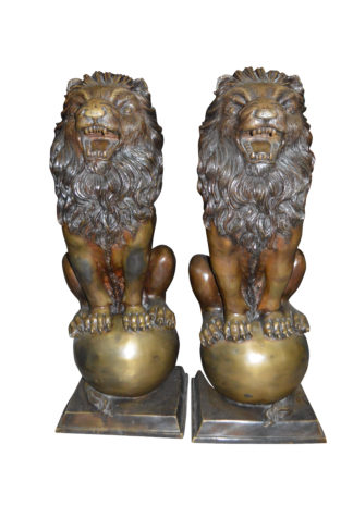 """Pair of lions standing on balls, bronze statues -  Size: 14""""L x 16""""W x 38""""H."""