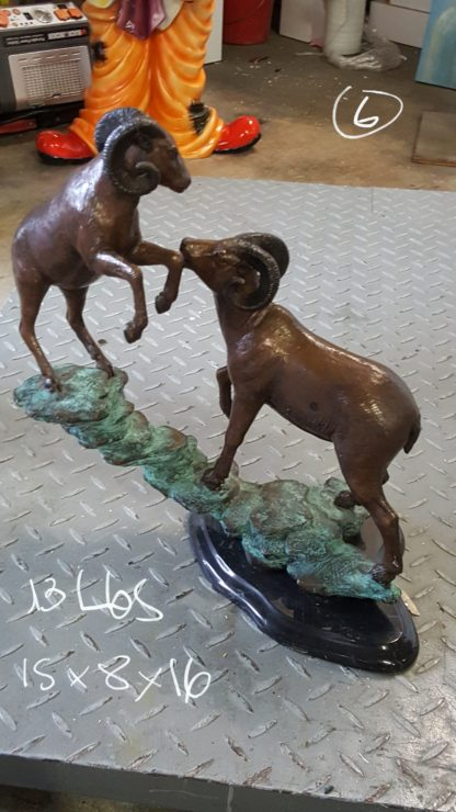 "Two Rams on a rock Bronze Statue -  Size: 15""L x 8""W x 16""H."