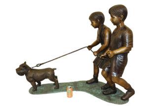"""Two Kids Walking a dog Bronze Statue -  Size: 55""""L x 28""""W x 37""""H."""